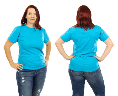Photo of a woman posing with a blank light blue t-shirt and red hair, ready for your artwork or design.
