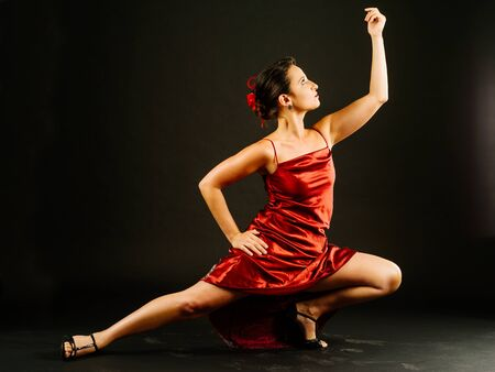 donna che balla: Photo of a young beautiful woman performing tango moves.