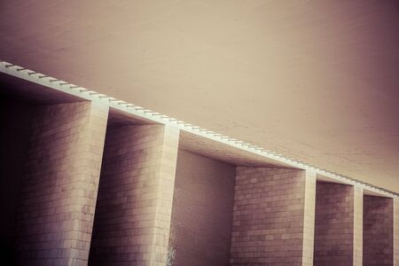 architectural exteriors: Photo of a abstract brick wall structure from a modern building. Stock Photo