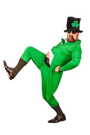 Photo of a man in a Leprechaun costume being silly and smoking a cigar. photo