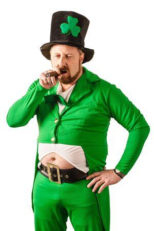 Photo of a man in a Leprechaun costume smoking a cigar. photo