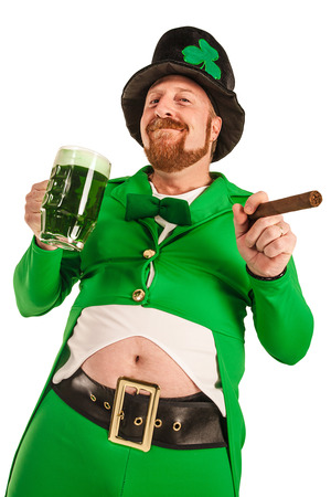 Photo of a man in a Leprechaun costume holding green beer and smoking a cigar. photo