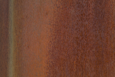 Closeup photo of a rusting metal surface.