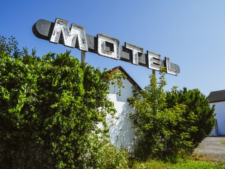 Photo of an old sign from an abandoned motel.