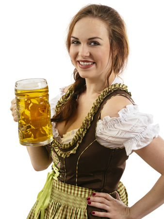 Photo of a beautiful female waitress wearing traditional dirndl and holding a beer steins over white background.