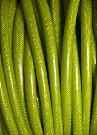 Rolled up of green PVC garden hose
