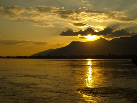 Cloudy Gold sunset in the sountern of Loas Stock Photo