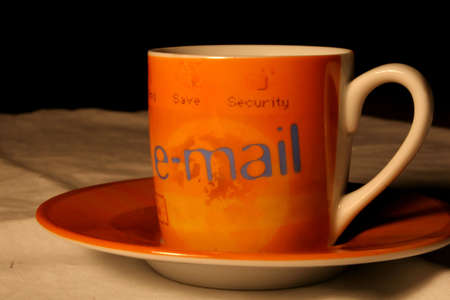 A coffee cup referncing email and internet