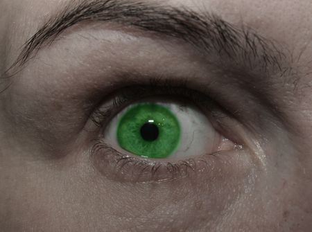 dilated pupils: A very very green eye Stock Photo