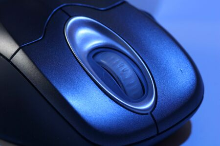 A wireless mouse in blue light Stock Photo - 289756