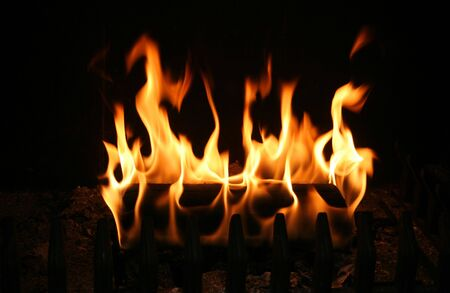 Log burning in a mountain cabin Stock Photo