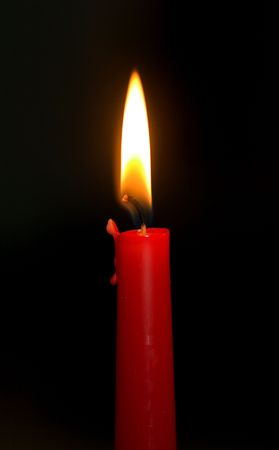 A single red candle burning Stock Photo