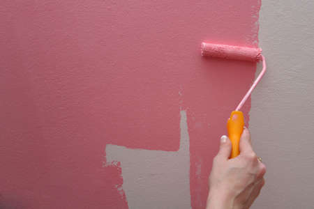 white wall being painted