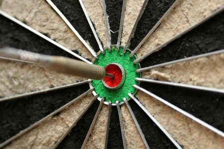 smack: Cropped shot of front of dart smack in the middle of the bulls eye Stock Photo