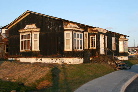 unkept: A beautiful old house in massive disrepair, rust and decay to much for repairs