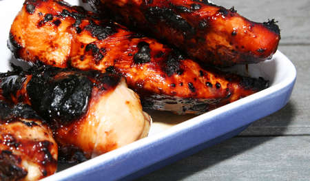 grilled chicken meat on a serving plate, cropped shot Stock Photo