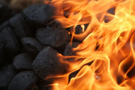 coals in a camping fire burning brightly Stock Photo
