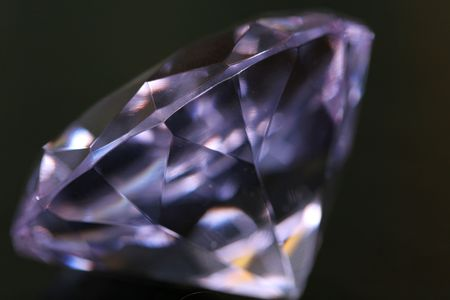 A clear purple diamond on black Stock Photo