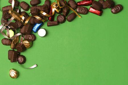 fine chocolate on green background , christmas ribbon Stock Photo - 755056