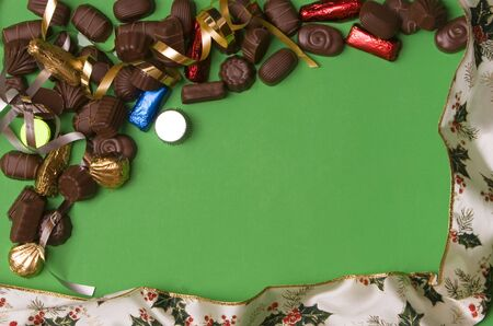 fine chocolate on green background , christmas ribbon Stock Photo - 755062