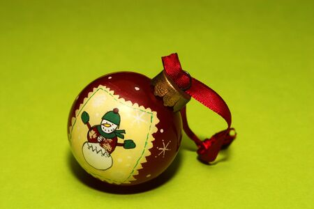 Christmas decoration, A decoration for a christmas tree on a green background photo