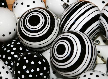 cropped shot: cropped shot of black and white christmas ball decorations. Stock Photo