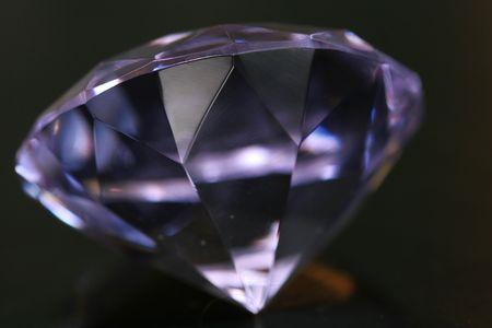 A clear purple diamond on black Stock Photo