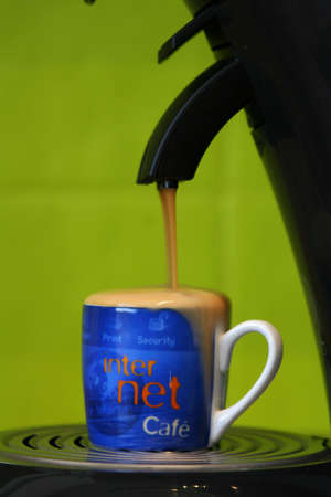 Coffeecup marked with internet filled to capacity and coffee spilling out of it Stock Photo - 754979