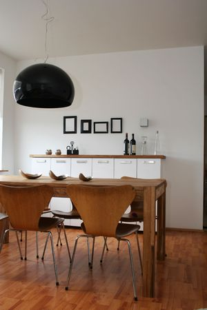 Modern living room, black and white decor, 4 empty black frames on wall
