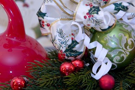 pine branch: A traditional christmas decoration, christmas ball with christmas bow tied to it, pine branch,  Stock Photo
