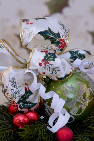 A traditional christmas decoration, christmas ball with christmas bow tied to it, pine branch, copy space Stock Photo - 754779