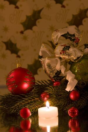 A traditional christmas decoration, christmas ball with christmas bow tied to it, pine branch, copy space photo