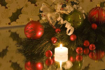 A traditional christmas decoration, christmas ball with christmas bow tied to it, pine branch, copy space