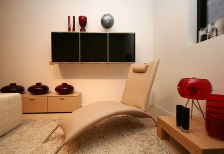 living room, with clean uncluttered and modern design, white leather recliner. Stock Photo