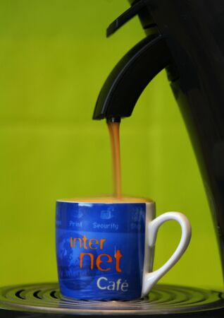 Coffeecup marked with internet filled to capacity and about spill over Stock Photo - 1080660