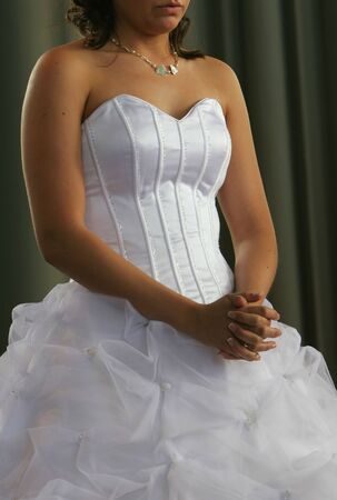 A real wedding, bride praying with hands clasped after ceremony, cropped shot without face Stock Photo - 1080689