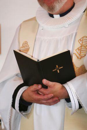 rites: A minister preaching in church
