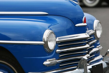photograph of an old classic car in mint condition, shining chrome and highly polished finish , absolutely beautiful photo