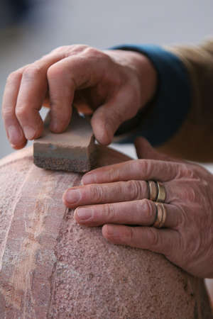 shot of craftsman working stone the old fashioned way Stock Photo