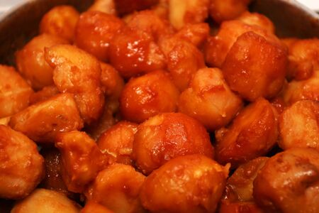 browned: A dish of sugar coated potatoes, browned and ready to serve
