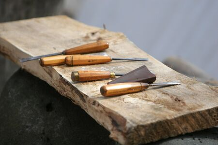woodworkers tools, lying on a piece of woodboard photo