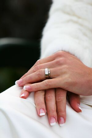 A wedding band on the hand of a new bride, cropped shot of hands and ring. Stock Photo - 1090874