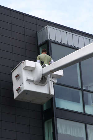Workers cleaning windows on a skyscraper