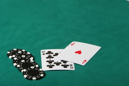Cards in a black jack game, player checking his hand Stock Photo - 1104427