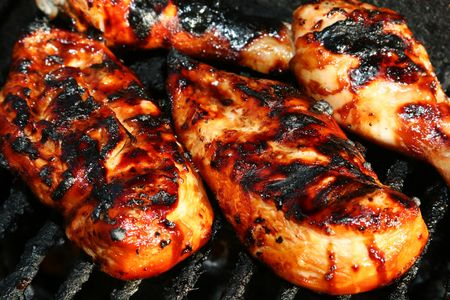 grilled chicken meat on the grill ready for eating Stock Photo
