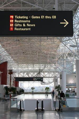 view of a airport sign pointing to various services Stock Photo - 1104464