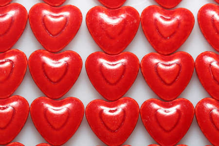 A close up of very red heart shaped candies photo