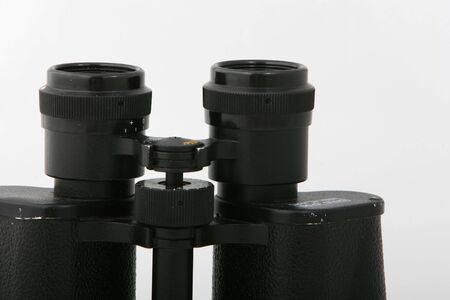 grime: Old vintage binauculars isolated on white, showing wear and tear, with dust and grime Stock Photo