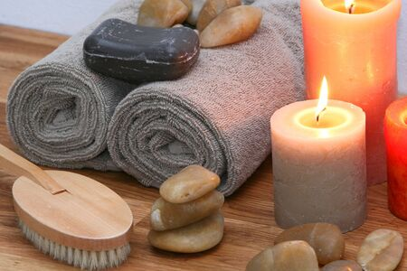 alternative living: A still live of spa items, set up on solid oak, very soothing eartly colors, Stock Photo