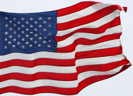 the US flag flying in the wind photo
